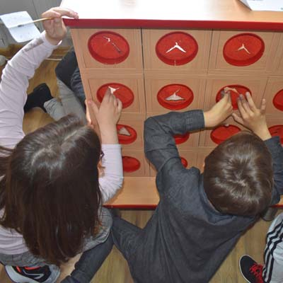 Romanian children insert hands into game to learn what is hidden
