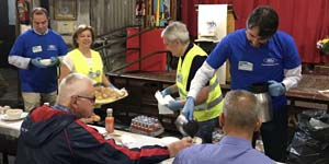 Ford employees serving breakfast in San Anton's church
